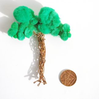 aerial view of large tree badge shown next to 2 pence coin