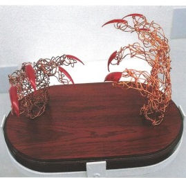 expressive wire hands with red talons displayed on wooden base