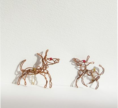 two wire dogs facing each other on a white background