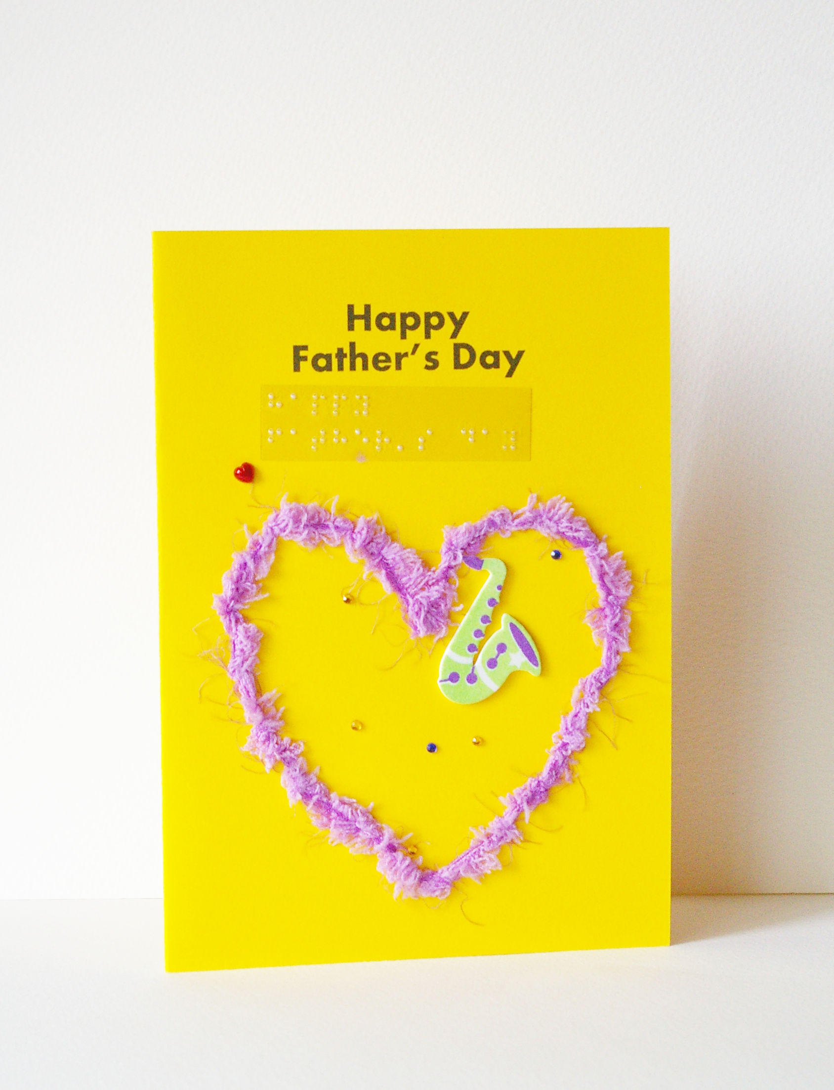 fluffy lilac heart happy father's day card with musical instrument sticker and tiny red hearts
